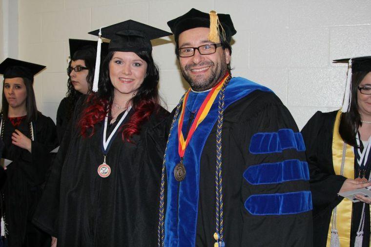 Miguel Gonzalez-Abellas offers his congratulations to a graduating Washburn student.