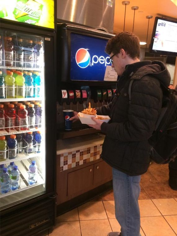 John Williams getting lunch in the Union's cafeteria. Passing up soda is not always an easy choice.