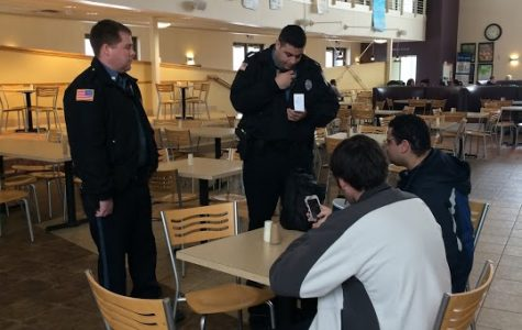 Officers Marcus Herrera and Andrew Putnam asking Raymond Vawter about his condition after his fall on ice. Students can view police reports filed at the WU Police office when open or read reports every week in the Washburn Review.