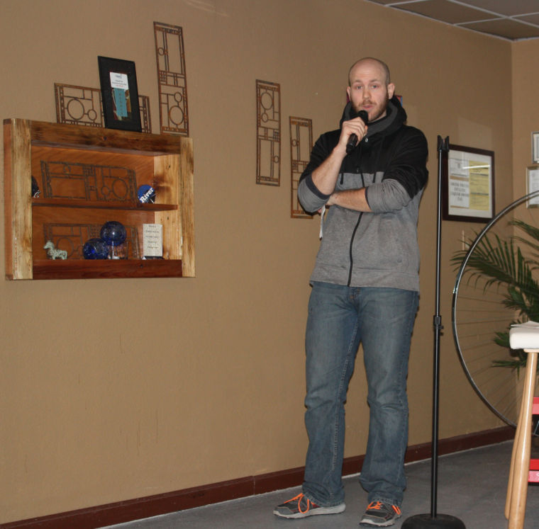 Alex Krumins works the room at NOTO's Riverfront Station 802. Krumins is one of Topeka's brightest up-and-coming comedians.