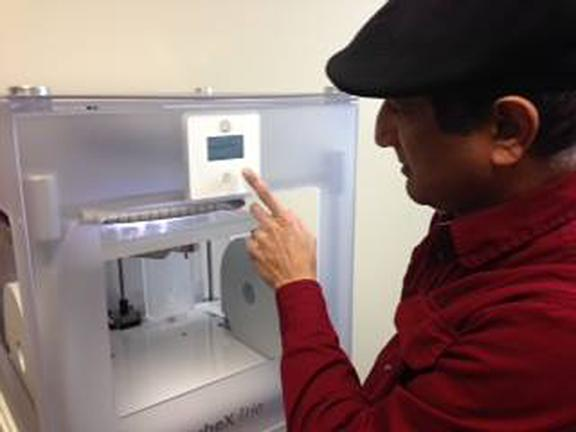 Professor Azyz Sharafy demonstrates how to run the new 3-D printer. Washburn hopes to make the printer available for student use in the future.