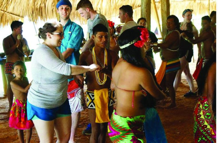 Rachel Benshoff, Kyle Quiett, Tyler Nelson, Sierra Valdivia and Alison Colonna enjoy dancing with members of the Emberá tribe.