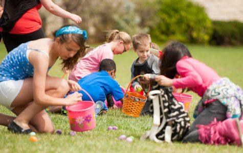 Gathering eggs in baskets at the Washburn Easter Egg Hunt.