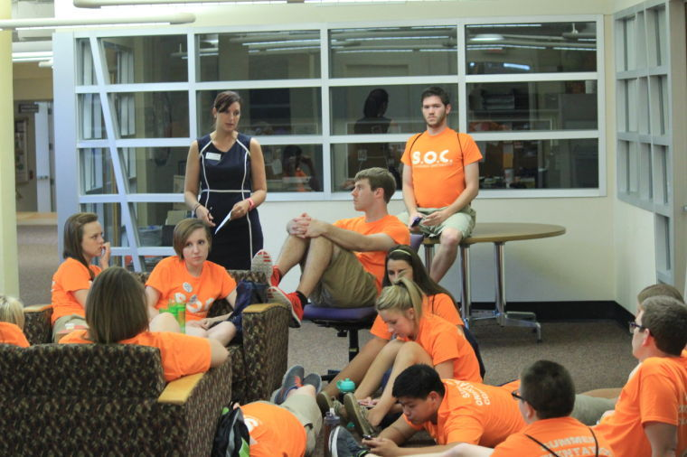 The summer orientation counselors gather in the lower level of the union after an orientation session.