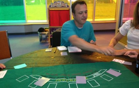 Kyle Morris, floor manager and program developer at the Discovery Center, deals out some cards for a non-gambling game of blackjack. The game was played due to the random nature of the cards demonstrating both luck and probability.