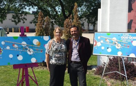 Staci Ogle, Art Director for the Aaron Douglas Art Fair, introduced Jaime Colon as this year's featured artist. The fair will take place on Saturday, September 27 at the Aaron Douglas Art Park at 12th & Lane.