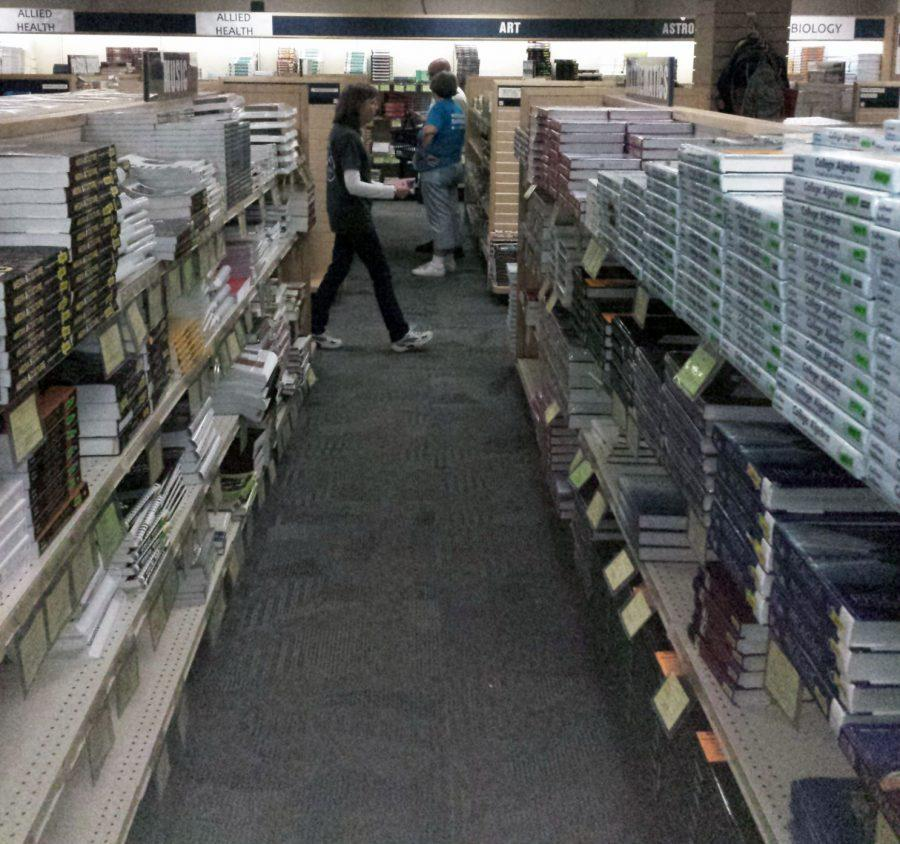 Ichabod Shop employees surf the stacks, helping students track down their textbooks for the fall semester.