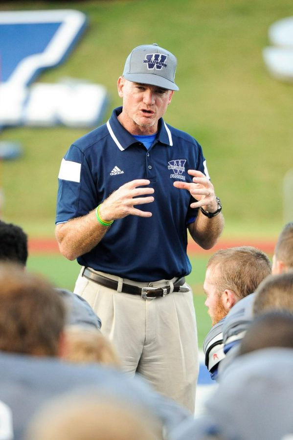 ENCOURAGEMENT: Washburn football head coach Craig Schurig speaks to hisplayers after a large loss to Pittsburg State. Schurig and his team have learned from thegame and are moving on and preparing to take on Missouri Southern Saturday, Sept. 27.