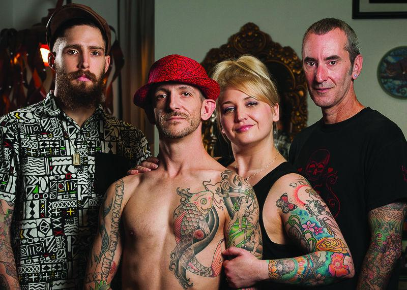 TATTED UP: Looking Glass Crew - Klayton Edwards, Danny White, Judith White and Chris Lyon prepare for the Looking Glass Tattoo's 10 year anniversary. Judith opened the business after traveling abroad and studying fine art at Washburn University. The celebration will be Oct. 10 at the 6th Avenue Ballroom.