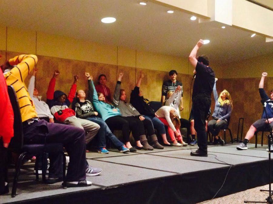 Tom+Deluca+hypnotizes+volunteer+students+during+his+performance.
