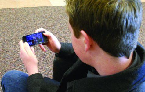 Washburn student Jack Vandeleuv watches