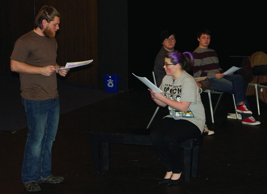The Others: [Foreground, left-right] Austin Swisher and Abbey Geiss run through their lines during a dress rehearsal for