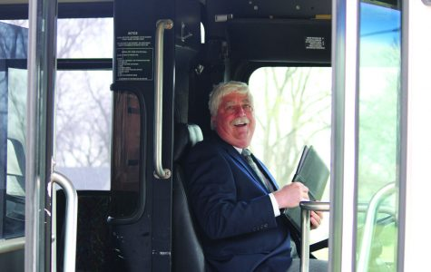 The Dean of Washburn Tech gets behind the wheel of the new bus.