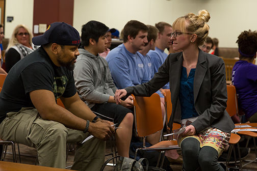 Washburn psychology professor Jericho Hockett speaks with students at last week's rally against sexual assault in Mabee Library. Hockett appeared at the rally to discuss the effects of sexual assault.