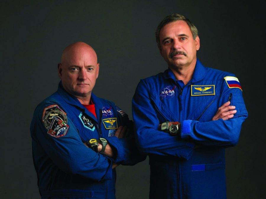 Scott Kelly, right, and Mikhail Korniyenko pose for their crew portrait. Kelly's twin brother Mark, not pictured, will remain on Earth for researchers to compare how the two differ on the genetic level after one year in orbit.