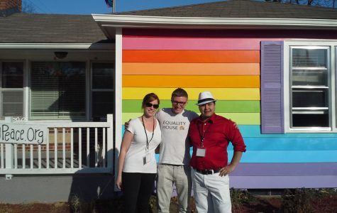 Director of Operations Davis Hammet (Middle) stands with two NOH8 volunteers in front of Equality House, as locals have their photos taken inside.