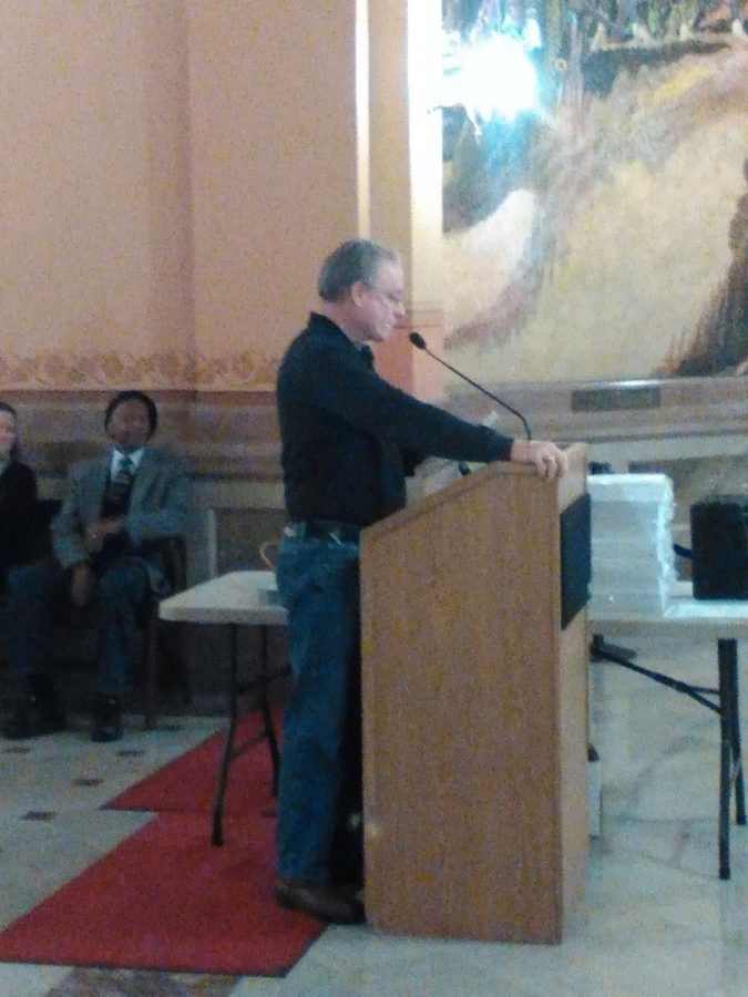 Al Frisby, a Merriam City Council member, speaks at the Rally to Restore Kansas Values.