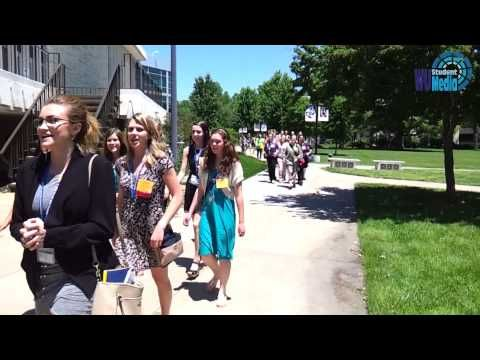 American Legionary Auxiliary sunflower girl state members marching at Washburn University campus