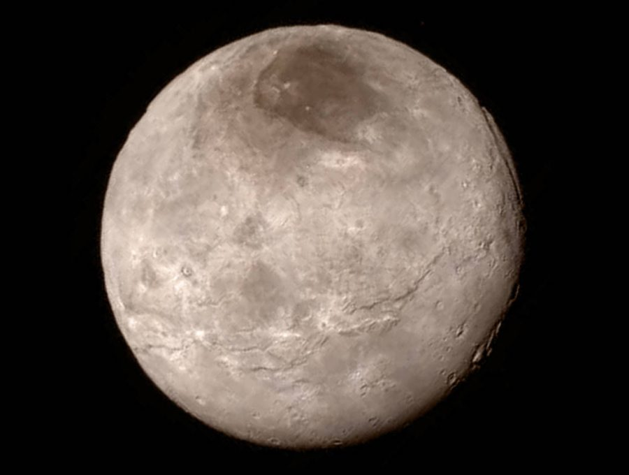 This+image+was+taken+of+Charon+from+a+distance+of+289%2C000+miles.+The+large+moon+has+very+few+craters.+This+means%2C+like+Pluto%2C+Charon+might+be+geologically+active.In+the+upper+part+of+the+image%2C+a+dark+feature%2C+nick-named+Mordor+by+the+mission+team%2C+is+seen+to+have+a+distinct+boundary+suggesting+it+is+a+thin+deposit+of+dark+material.+Higher+resolution+images+will+be+sent+back+by+the+spacecraft+in+the+coming+days.