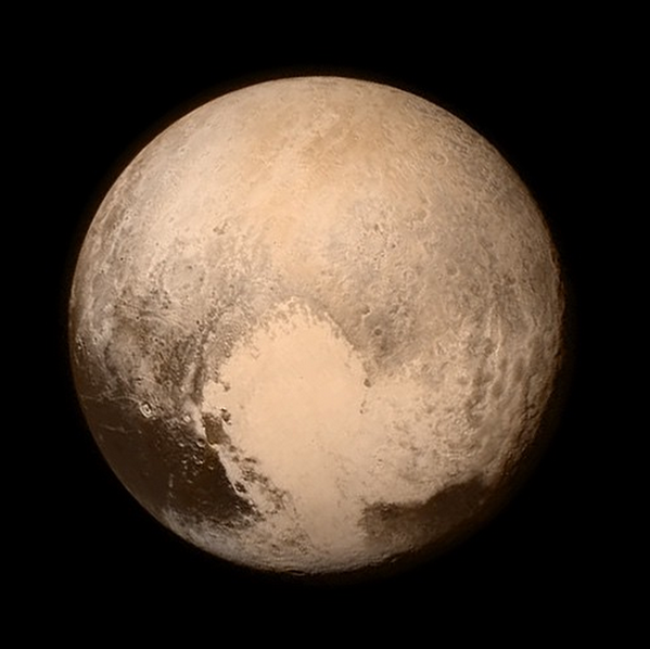 Pluto, only hours from closest approach reveals a heart shaped region, formally named Tombaugh Regio after Pluto's discoverer Clyde Tombaugh.