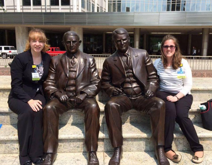 Blaire Landon, left, and fellow extern, Jessica Atton, next to a statue of Will and Charles Mayo. While in Rochester, she and other externs were given a tour of the city as well as the home where the Mayo's lived.