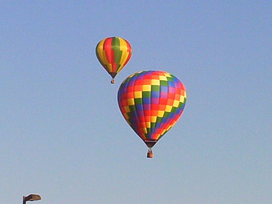 Two balloons launch into Topeka skies at last year's Huff 'N Puff hot air balloon rally.