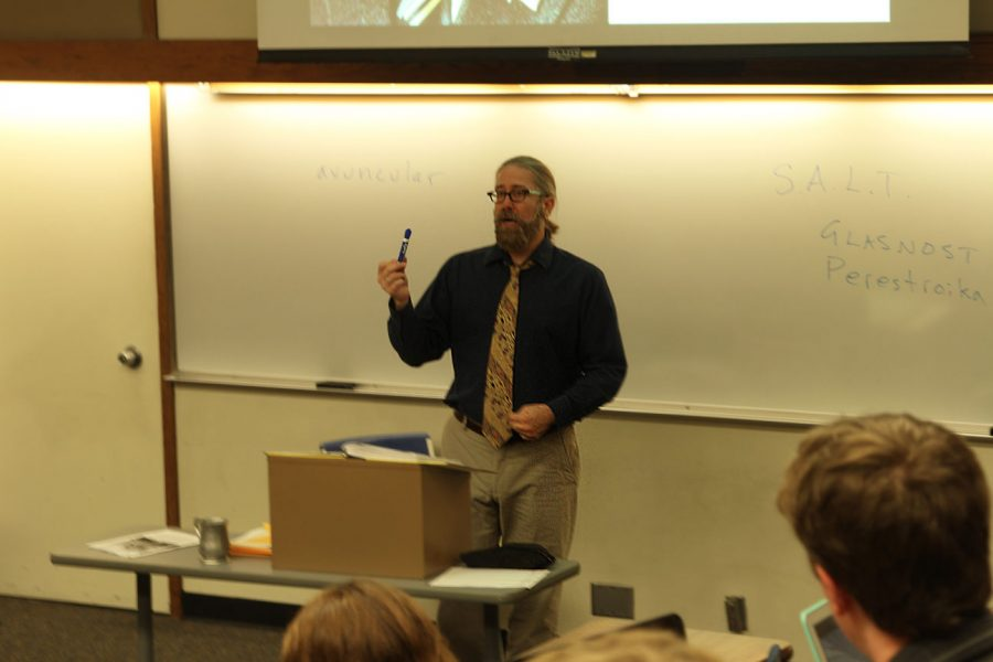 Dr. Tony Silvestri lectures to his students during a history class.