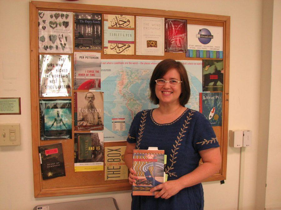 Laura Da displays her most recently published book,