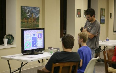 Michael Hernansez from Warp Zone Retroplex lets gamers try out his systems and take on challenges.
