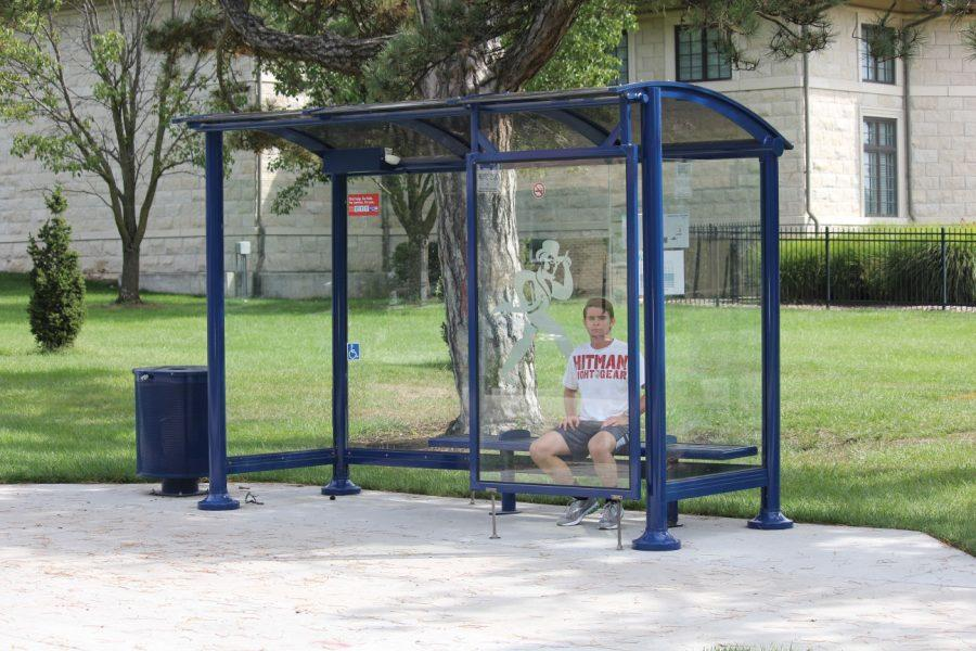 Dante Overbey, a sophomore pre-engineering student, waits for a bus at the 17th street bus stop, north of the Washburn campus.