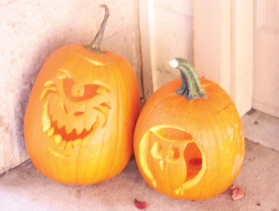 Washburn+Village+residents+display+their+Halloween+spirit+by+decorating+their+doorways+with+creatively+carved+pumpkins.