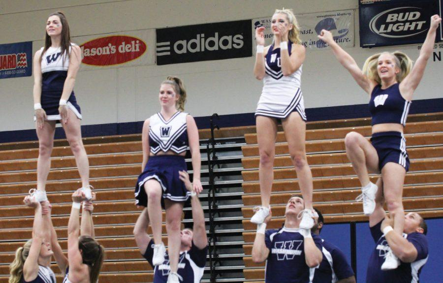The+Washburn+cheer+team+performs+their+routine+at+Yell+Like+Hell.+The+cheer+team+and+Dancing+Blues+both+performed+but+were+not+judged+in+the+competition.