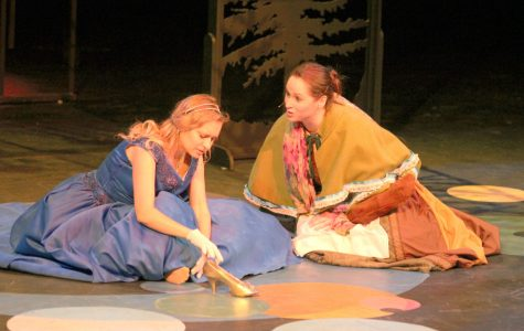 Cinderella (Anna Tague) and the Baker's Wife (Allison Ralstin) discuss Cinderella's trip to the Festival while the Baker's Wife tries to steal Cinderella's shoe to lift the curse on her family.