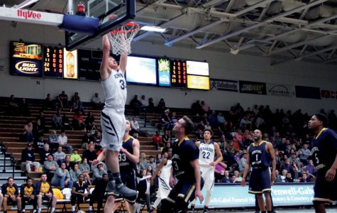 Jeremy Lickteig slams home a two handed dunk against the Bronchos. It was his only make on three attempts but Washburn's only dunk of the game.