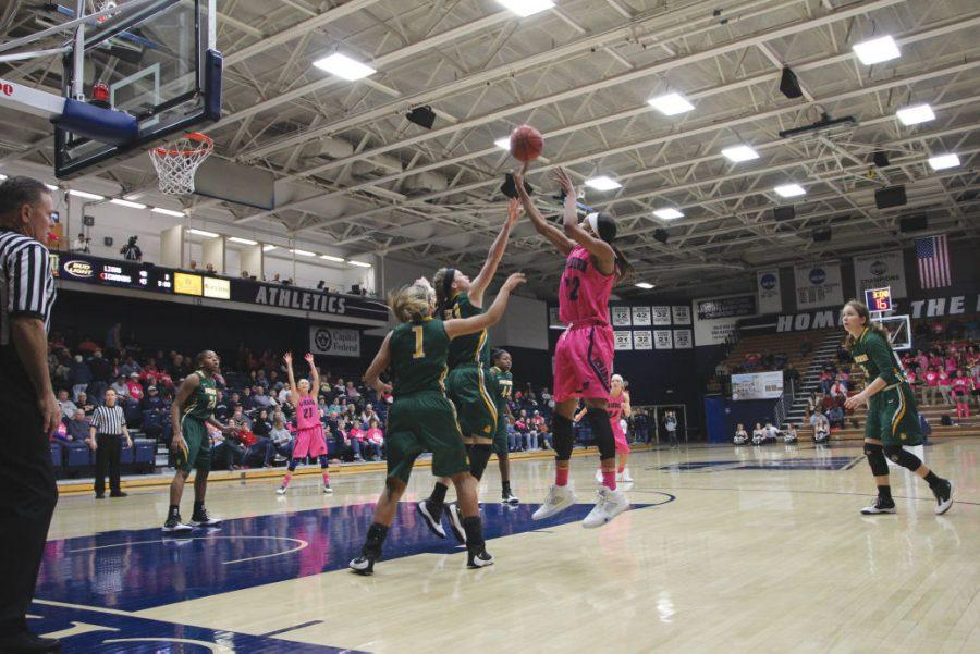 Alyxis Bowens takes a jumper over two Lions in Saturday's loss. Bowen had 12 points, shooting six for 10 from the field.