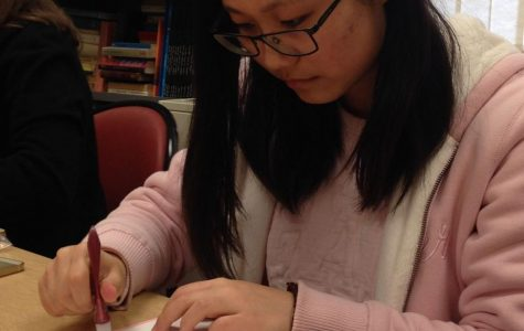 Xinyi Cao, English major, creates one of the cards that the French Club will be selling onFeb. 10from11 a.m. to 1 p.m.in the Memorial Union.