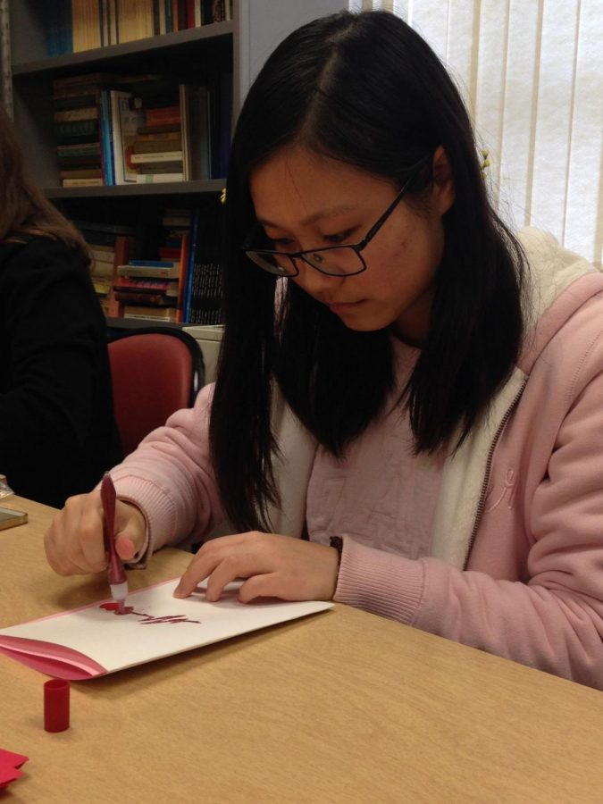 Xinyi Cao, English major, creates one of the cards that the French Club will be selling on Feb. 10 from 11 a.m. to 1 p.m. in the Memorial Union.