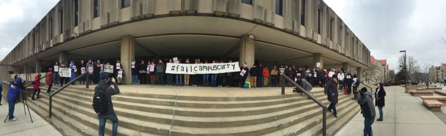 "The protesters from universities across Kansas such as KU, Kansas State, Washburn and Fort Hays State held signs that said ""#failcampuscarry"" and ""love guns? Take classes online."""