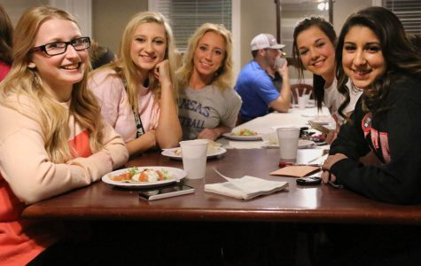 (Left to right) Alexis Williams, Maranda Ballou, Megan Reed, Brianna Boette and Gabby Rodriguez sit down to enjoy their homemade tacos. Washburn students bought tickets for the tacos to raise money for breast cancer awareness and education on March 2.