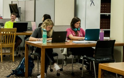 Students in the first floor of the Mabee library study for classes Tuesday night. The library partnership will allow students to check out books from the public library and deliver them to Mabee for pick up.
