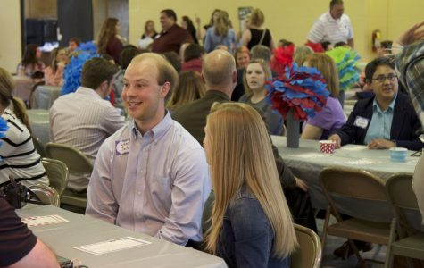 Jack Van Dam excitingly mingles with guests at the beginning of the Leadership Institute spring banquet April 19.