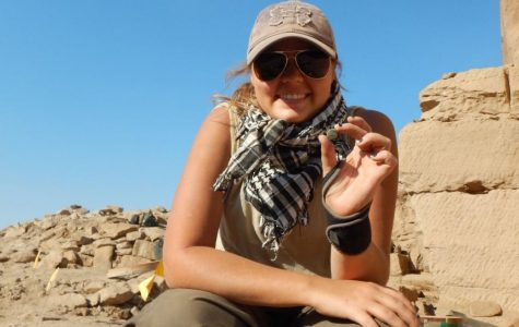 Shelby Beltz, sophomore, anthropology major, showcases her a piece of jade she found during her trip to Belize.