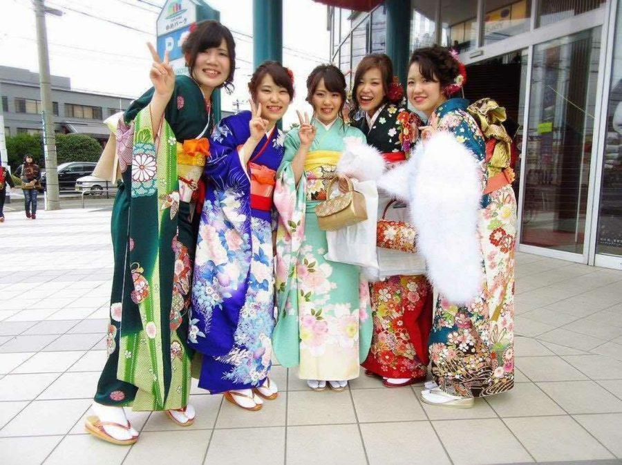 """Sharing Japanese culture with new friends: Natsuki Taka (middle), one of the new visiting Japanese students from Fukuoka University showing her """"Coming-of-Age Day"""" picture in social time. """"Coming-of-Age Day"""" isa national holiday in Japan to encourage those who have newly entered adulthood to become self-reliant members of society. Municipal governments host special coming-of-age ceremonies for 20-year-olds."""