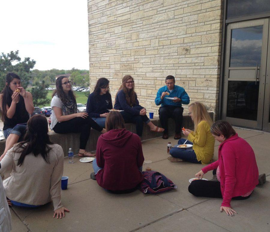 Psychology students and faculty munch on homemade food provided by Psi Chi and faculty members during the bi-annual psychology department picnic. The picnic took place on April 20 outside of Henderson and allowed students to mingle with fellow classmates and feel a part of the program.