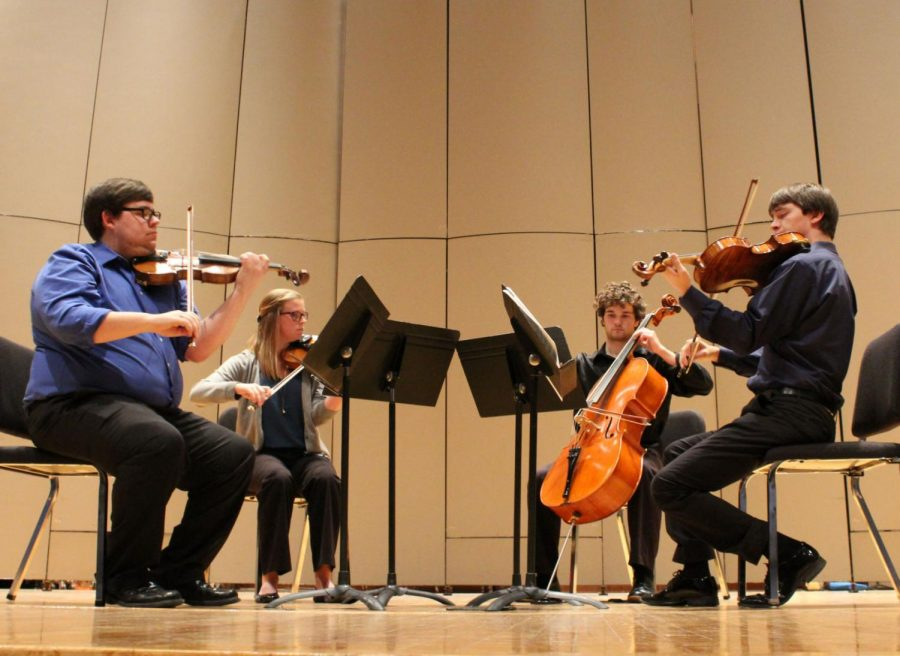 Strings: Ryan Masotto and Samantha Silver perform with the other members of the Fetter String Quartet in their November recital. Alongside their work in the Quartet, the two also play in solo recitals and teach viola and violin lessons to any wanting to learn.