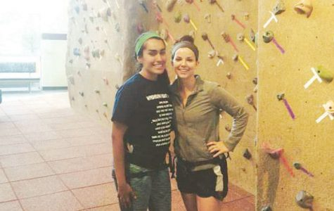 Kasey Paez (left) and Allie Bellinger (right) take advantage of the SRWC to learn how to climb a rock wall. The SRWC is free for Washburn students.