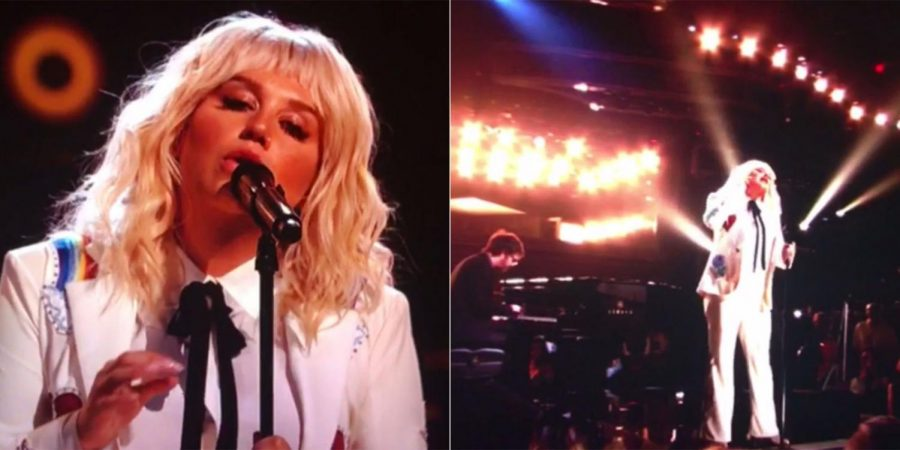 "Honoring Bob Dylan: 29-year-old Pop star Kesha, widely known for her hits such as ""Tik Tok"" and ""We R Who We R"" and an affinity for glitter, hit another wall in her legal battle with music producer Lukasz ""Dr. Luke"" Gottwald. She wore a white pantsuit during her moving performance."