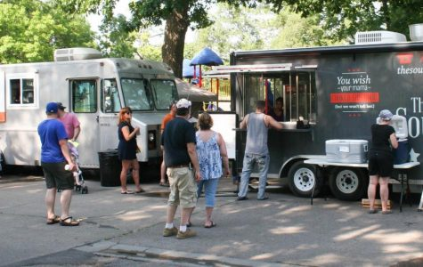 Customers buy food at Snoutherns and The Southern Star. Both trucks are from Topeka.