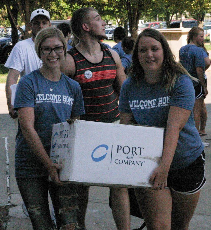Residential Living Staff and volunteers assisting new and returning students in moving on campus. Move-In initiated Welcome Week in the morning of August 18.