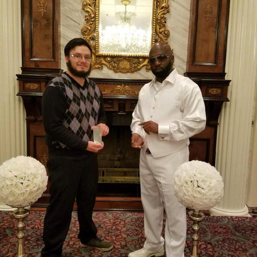 Matt Spezia holding the slam artist of the year award with Blaq Ice. Blaq Ice nominated Spezia for the award.